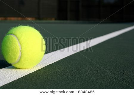 Tennis Ball On A Diagonal Court Line