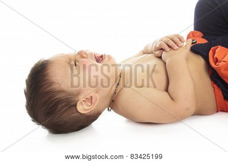 A baby is on a white background very sad and starting to cry.