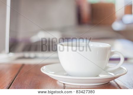 White Coffee Cup On Work Station