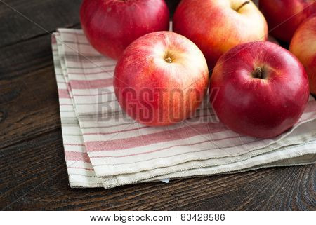 Some Red Apples On The Napkin