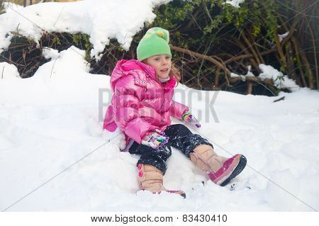 Tired Little Girl In The Snow