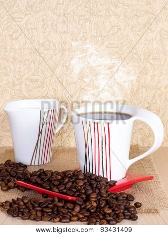 Cup of coffee with saucer, milk jug and coffee beans on the table