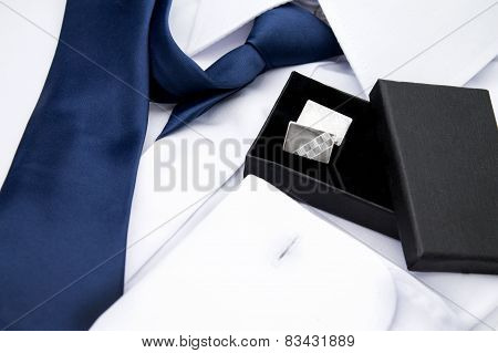 Man's white shirt with tie and cufflinks