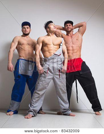 Three sexy man in working overalls
