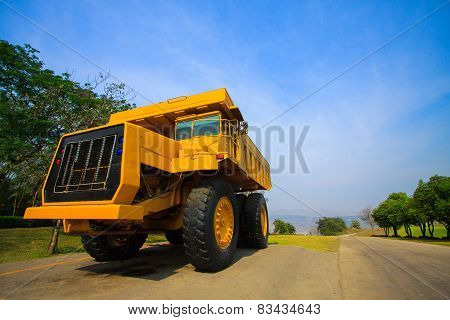 Heavy mining truck in mine and driving along the opencast. Photo of the big mine truck