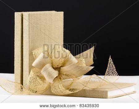 Three books with ribbon bow