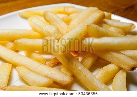 Tasty Golden French Fries On A Plate