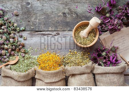 Healing Herbs In Hessian Bags, Wooden Mortar And Recipes, Herbal Medicine. Top View.