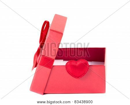 Red Box With The Lid Open With A Ribbon On A White Background