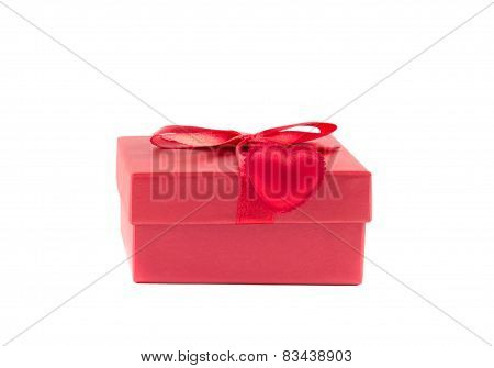 Red Box With A Ribbon With Heart On A White Background