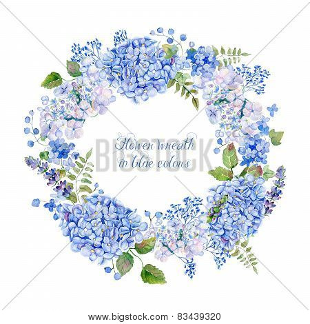 Round frame of blue hydrangea and other flowers.