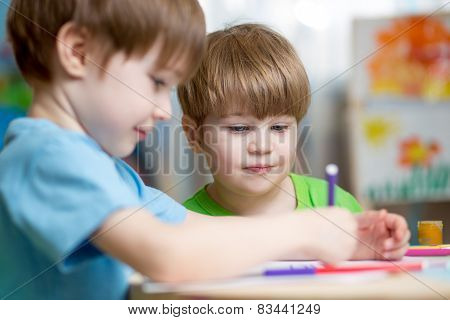 kids boys painting in nursery at home