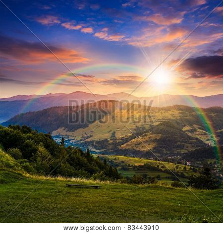 Village Near Forest In High Mountains At Sunset