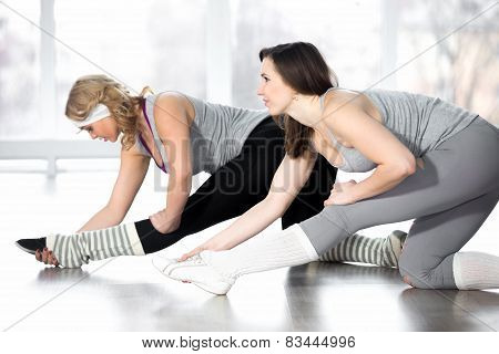 Sporty Young Females Doing Stretching Aerobics Exercises