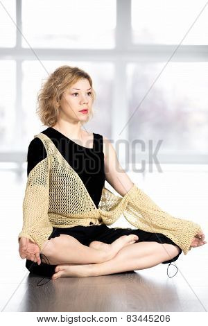 Serene Yogi Female Resting In Cross-legged Yoga Pose