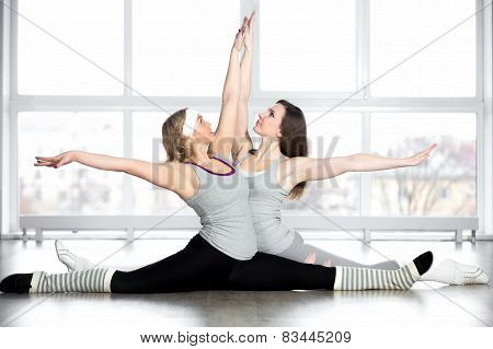Sporty Young Dancers Doing Splits
