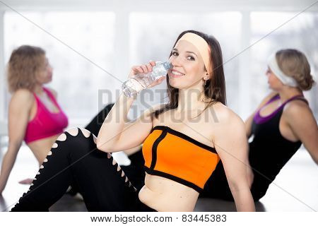 Sporty Girl Drinking Water After Sport Practice In Gym