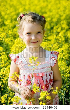 Little Girl In Yellow Rape Field