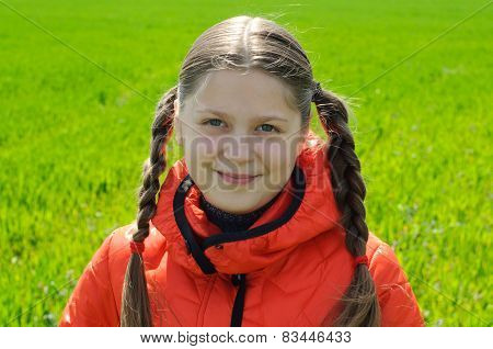 An Image Of Little Girl In Green Field