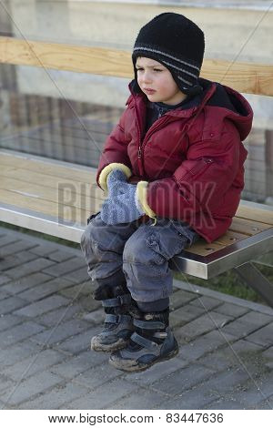 Child Waiting At Bus Stop