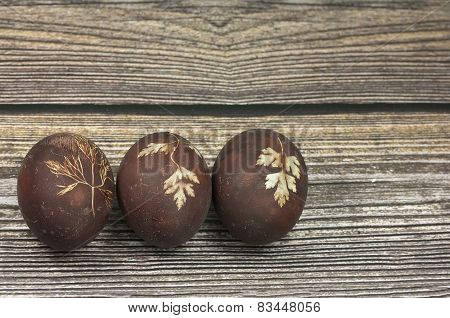 Three Easter Eggs On Wooden Background