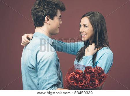 Smiling Woman Receiving A Love Gift