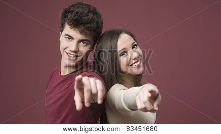 Happy Young Couple Pointing