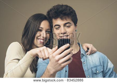 Cheerful Young Couple With Mobile Phone