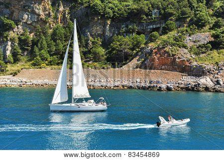 Boats Sailing Near The Coastline