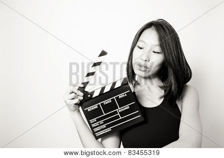 Young Beautiful Asian Woman Looking At  Clapperboard Black And White