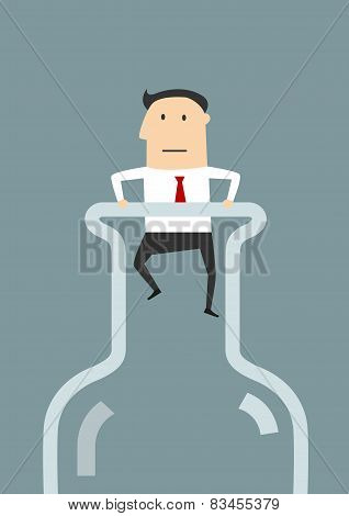 Businessman in the neck of glass bottle