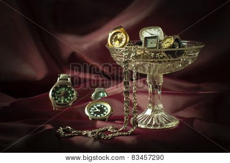 Old clockwork mechanical watches in a vase