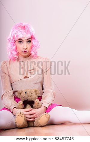 depressed sad woman with teddy bear