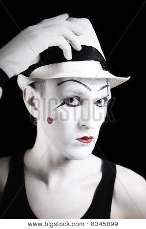 Ape Mime In Striped Gloves And White Hat On Black Background