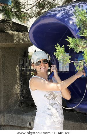 Smiling Woman At Payphone