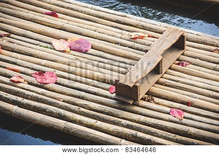 Bamboo Raft With Red Leaves.