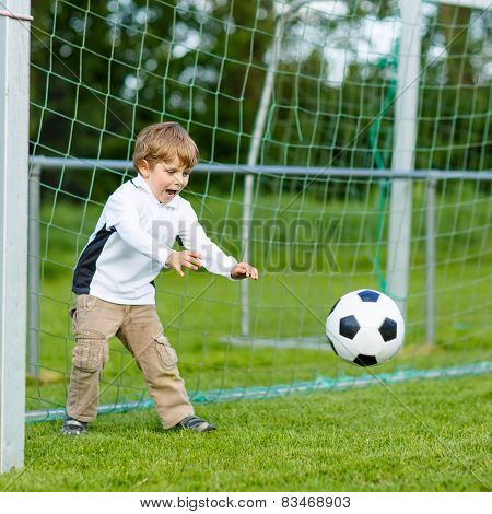 Two Little Sibling Boys Playing Soccer And Football On Field