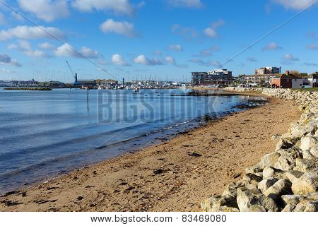 View towards Poole harbour and quay Dorset England UK with sea and sand on a beautiful day