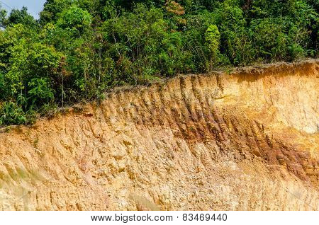 Layer Of Soil Front Loader Strips All Side Of A Hill
