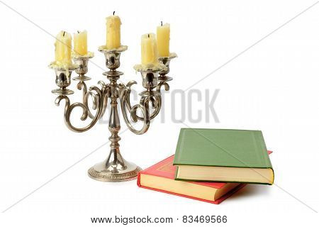 Candlestick And Books Isolated On White Background