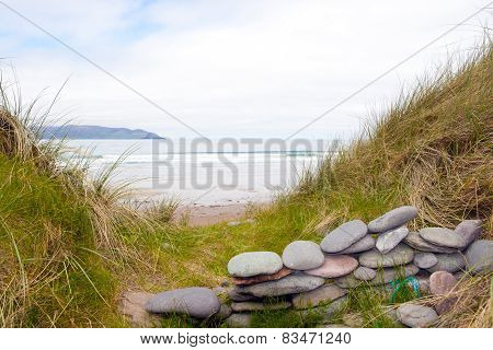 Stone Wall Shelter On A Beautiful Irish Beach