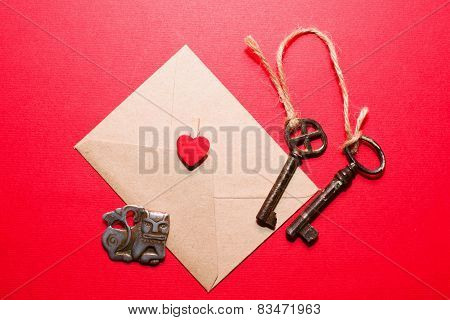Envelope With Heart, Two Keys And Little Monster On A Red Background.