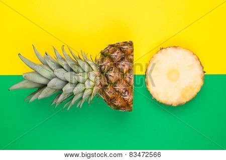 Tropical pineapples on green and yellow background
