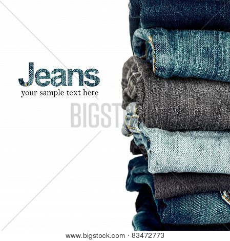 Stack Of Grungy Different Shades Of Blue Jeans As A Background
