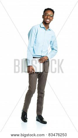 Happy African American College Student With Laptop Standing On White