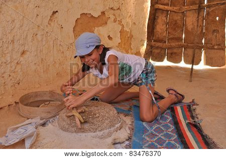 The Girl Grinding Flour In The Mill. Tourism In Ezgotycznych Countries. Round Trip. Berber Culture.