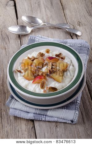 Rice Pudding With Nectarines And Roasted Almond Sliver