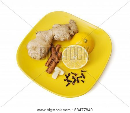 Ginger, Cinnamon, Lemon, Garlic And Cloves On The Plate