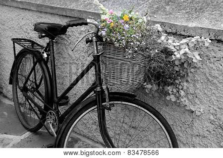 Image of rustic bike against stone wall