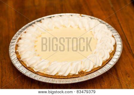 Whole Lemon Meringue Pie On Wood Table